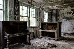 Vintage Piano and Couch - Abandoned Hospital / Sanitarium - New York. An interior view of a vintage piano and couch inside an abandoned hospital in New York stock photography