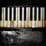 A Vintage Piano Keyboard With Charred Wood Accent. Stock Image