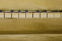 Vintage Piano Keys. Close-up view of an antique piano including black and white keys Royalty Free Stock Image