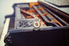 Vintage piano keys with antique pocket watch – time concept Stock Photography