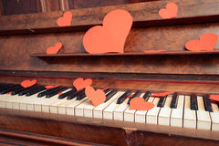 Vintage piano with paper hearts Royalty Free Stock Photo