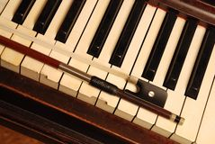 Vintage Piano and violin bow Stock Photography