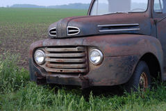 Vintage pick up truck. Rusty old pick up truck in rural field Royalty Free Stock Photography