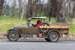 Vintage pickup truck driving on country road. Adelaide, Australia - September 25, 2016: Vintage pickup truck driving on country roads near the town of Birdwood Royalty Free Stock Photo