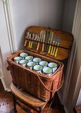 Vintage Picnic Basket On Wicker Chair Stock Photo