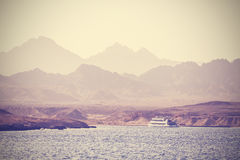Vintage picture of a boat on the sea. Royalty Free Stock Photos