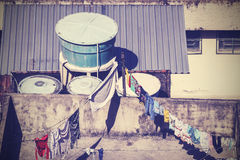 Vintage picture of clothes drying on rooftop. Stock Image