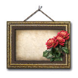 Vintage picture frame and a bouquet of red roses Stock Photo