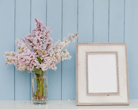 Vintage picture frame and bunch of lilac Stock Images