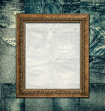 Vintage picture frame on collage jeans Stock Photos