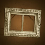 Vintage picture frame on old dirty wall Stock Photo