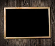 Vintage picture frame on wooden wall Royalty Free Stock Photography