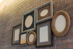 Vintage picture frames blank on brick wall. Royalty Free Stock Photo
