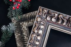 Two wooden picture frames on black background. Christmas decor. Vintage picture frames. Framing workshop concept stock photography