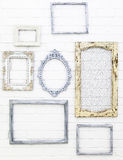 Vintage picture frames on white brick wall stock image