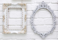 Vintage picture frames on white brick wall. Background Royalty Free Stock Images