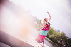 Vintage picture of gracious young woman dancing by Royalty Free Stock Photo