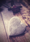 Vintage picture of heart on a wooden background. Royalty Free Stock Photo