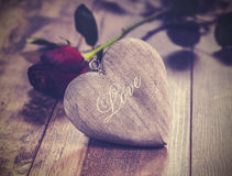 Vintage picture of heart on a wooden background wi Stock Photos