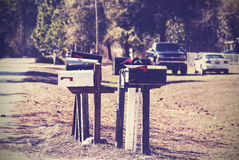 Vintage picture of mail boxes, rural area, USA. Stock Images