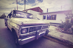 Vintage picture old broken car on a village road Stock Images