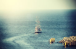 Vintage picture of old sailing ship leaving port Royalty Free Stock Photography