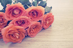 Vintage picture of orange roses on wooden background with copy space for some text, Concept of love, Valentines Day background, we Royalty Free Stock Photo