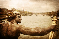 Vintage picture of Paris. Vintage style picture of a sculpture on the Seine bridge Pont Alexandre in Paris with the Eiffel tower in the far background, overlaid Royalty Free Stock Photo