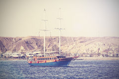 Vintage picture of a sailing boat on the sea. Royalty Free Stock Photos