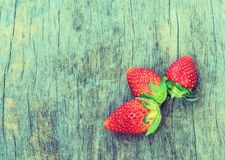 Vintage  picture   strawberry  on wood background Stock Photos