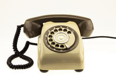 Vintage picture style of new smart phone with old telephone on white background. New communication technology Royalty Free Stock Image