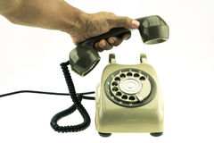 Vintage picture style of new smart phone with old telephone on white background. New communication technology Royalty Free Stock Photos