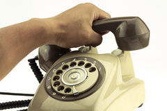 Vintage picture style of new smart phone with old telephone on white background. New communication technology Royalty Free Stock Photography