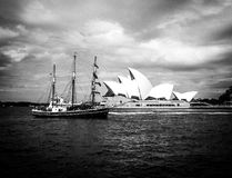 Vintage picture of Sydney opera house. Taken in 2016, the picture shows the opera house as well as an historic sail ship. Taken in black and white and adding Royalty Free Stock Photo