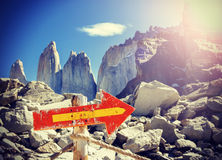 Vintage picture of wooden direction sign post on a mountain path.  royalty free stock image