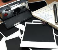 Vintage pictures. Vintage instant camera and several photo frames royalty free stock photos