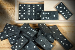 Vintage Pieces of Domino Game with Box Royalty Free Stock Images