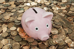 Vintage Piggy Bank Chin Deep in Pennies Royalty Free Stock Photos
