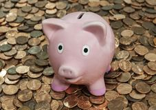 Vintage Piggy Bank on Penny Pile Stock Image