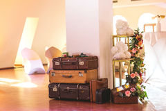 Vintage Pile of Ancient Suitcases. Design and travel concept. Luggage. Flower arch. Origami Stock Photography