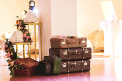 Vintage Pile of Ancient Suitcases. Design and travel concept. Luggage. Flower arch. Origami Stock Images