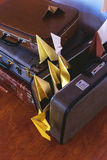 Vintage Pile of Ancient Suitcases. Design and travel concept. Luggage. Paper airplanes. Origami Stock Photo
