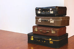Vintage Pile of Ancient Suitcases. Design and travel concept. Luggage. Paper airplanes. Origami Stock Image
