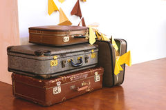 Vintage Pile of Ancient Suitcases. Design and travel concept. Luggage. Paper airplanes. Origami Royalty Free Stock Image