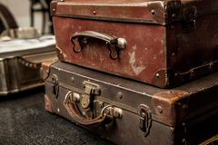 Vintage Pile Ancient Suitcases Form of Tower Design Concept Travel Luggage on a vintage living room stock images