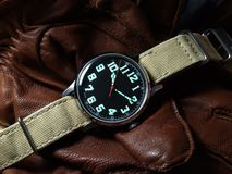 Vintage pilot watch. Over brown leather globes stock image