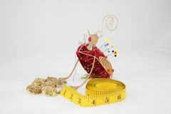 Vintage pin cushion. With tape measure and buttons royalty free stock photography