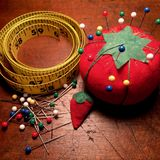 Vintage pin cushion and tape measure Stock Photo