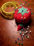 Vintage pin cushion and tape measure royalty free stock photos
