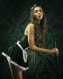 Vintage pin up maid's uniform, holding a broom Royalty Free Stock Image